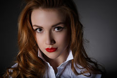 Beautiful young woman in a white man's shirt Royalty Free Stock Photo
