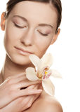 Beautiful young woman with white  orchid Royalty Free Stock Images