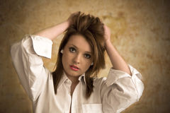 Beautiful young woman in white shirt on grunge Stock Photo