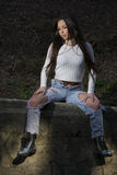 Beautiful young woman. Young woman with white shirt and ripped jeans Royalty Free Stock Photography