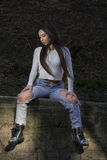 Beautiful young woman. Young woman with white shirt and ripped jeans royalty free stock images