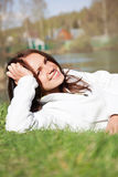 Beautiful young woman in a white sweatshirt Stock Photography
