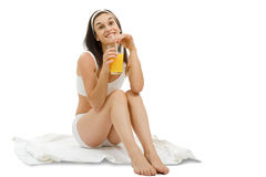 Beautiful young woman in white underwear with orange juice, on w Royalty Free Stock Photo