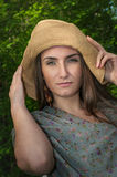Beautiful young woman in wide hat Royalty Free Stock Photo