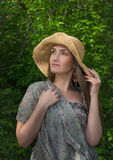 Beautiful young woman in wide hat Stock Photo