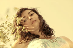 Beautiful, young woman among wildflowers Royalty Free Stock Photography