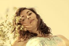 Beautiful, young woman among wildflowers royalty free stock photography