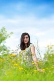 Beautiful young woman among wildflowers Royalty Free Stock Photo