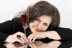The beautiful young woman with wine glass Stock Photos