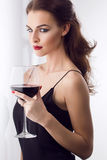 Beautiful young woman with wine glass Royalty Free Stock Photos