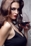 Beautiful young woman with wine glass stock photography