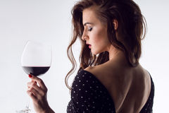Beautiful young woman with wine glass Stock Photo