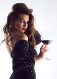 Beautiful young woman with wine glass Royalty Free Stock Images