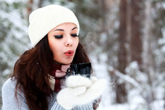 Beautiful young woman in winter forest Stock Photo