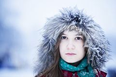 Beautiful young woman in winter forest Royalty Free Stock Photos