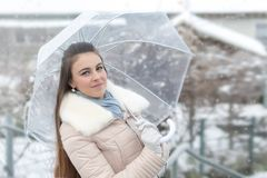 Young woman in winter forest. Beautiful young woman in winter forest Royalty Free Stock Images