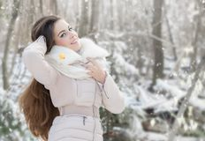 Young woman in winter forest. Beautiful young woman in winter forest Stock Image