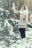 Young woman in winter forest. Beautiful young woman in winter forest Royalty Free Stock Photos