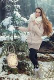 Young woman in winter forest. Beautiful young woman in winter forest Royalty Free Stock Photography