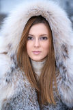 Beautiful young woman in winter fur coat Royalty Free Stock Images