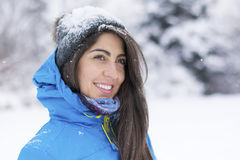 Beautiful young woman in  the winter mountain Stock Photography