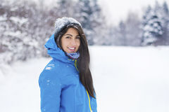 Beautiful young woman in  the winter mountain Stock Photo