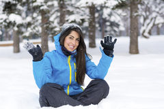 Beautiful young woman in  the winter mountain Royalty Free Stock Images