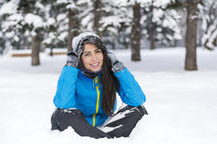 Beautiful young woman in  the winter mountain Royalty Free Stock Image