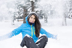 Beautiful young woman in  the winter mountain Stock Image
