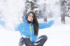 Beautiful young woman in  the winter mountain Royalty Free Stock Photo
