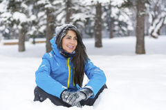 Beautiful young woman in  the winter mountain Stock Images