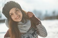 A Beautiful young woman in winter outside stock image