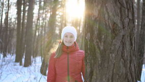 Beautiful young woman in winter park, having fun, smiling. Slow motion video. stock footage