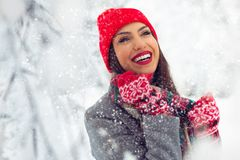 Beautiful young woman in winter park - Image stock photography