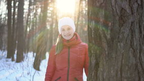 Beautiful young woman in winter park, smiling, and having fun. Slow motion video. stock video footage