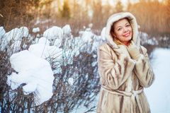 Woman in the winter park Stock Images