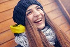 Beautiful young woman in winter. Beautiful young smiling woman outside in the winter Stock Image