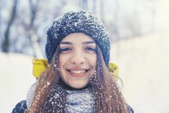Beautiful young woman in winter. Beautiful young smiling woman outside in the winter Stock Photos