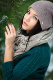 Beautiful young woman in wintertime outdoor Royalty Free Stock Image