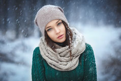Beautiful young woman in wintertime outdoor royalty free stock images