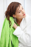 Beautiful young woman wipes her hairs Royalty Free Stock Photography