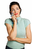 Beautiful young woman wiping tears. With handkerchief. 1950's look isolated over white Royalty Free Stock Images