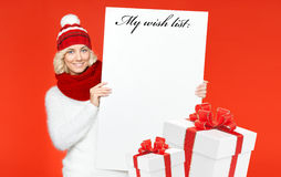 Beautiful young woman with wish list. Christmas portrait Stock Image