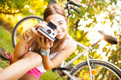 Beautiful Young Woman With A Vintage Camera Stock Photography
