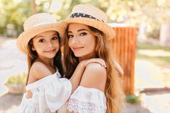 Free Beautiful Young Woman With Big Green Eyes Holding Daughter Wich Looking To Camera With Surprised Face Expression. Close Royalty Free Stock Photo - 172379045