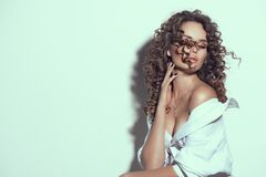 Free Beautiful Young Woman With Curly Hair Posing, Beauty Model Portrait, Closeup. Beautiful Sexy Model Girl In White Cotton Shirt Royalty Free Stock Photography - 200880417