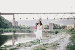 Free Beautiful Young Woman With Long Curly Hair Dressed In Boho Style Dress Posing Near Lake Royalty Free Stock Photo - 73363365