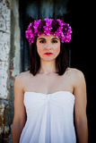 Beautiful Young Woman With Pink Flowers And White Dress. Royalty Free Stock Photo