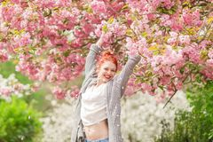 Beautiful Young Woman With Red Hair Having Fun Standing In Cherry Blossom Tree Stock Images