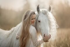 Free Beautiful Young Woman With White Tinker Cob In An Autumn Royalty Free Stock Image - 180209066